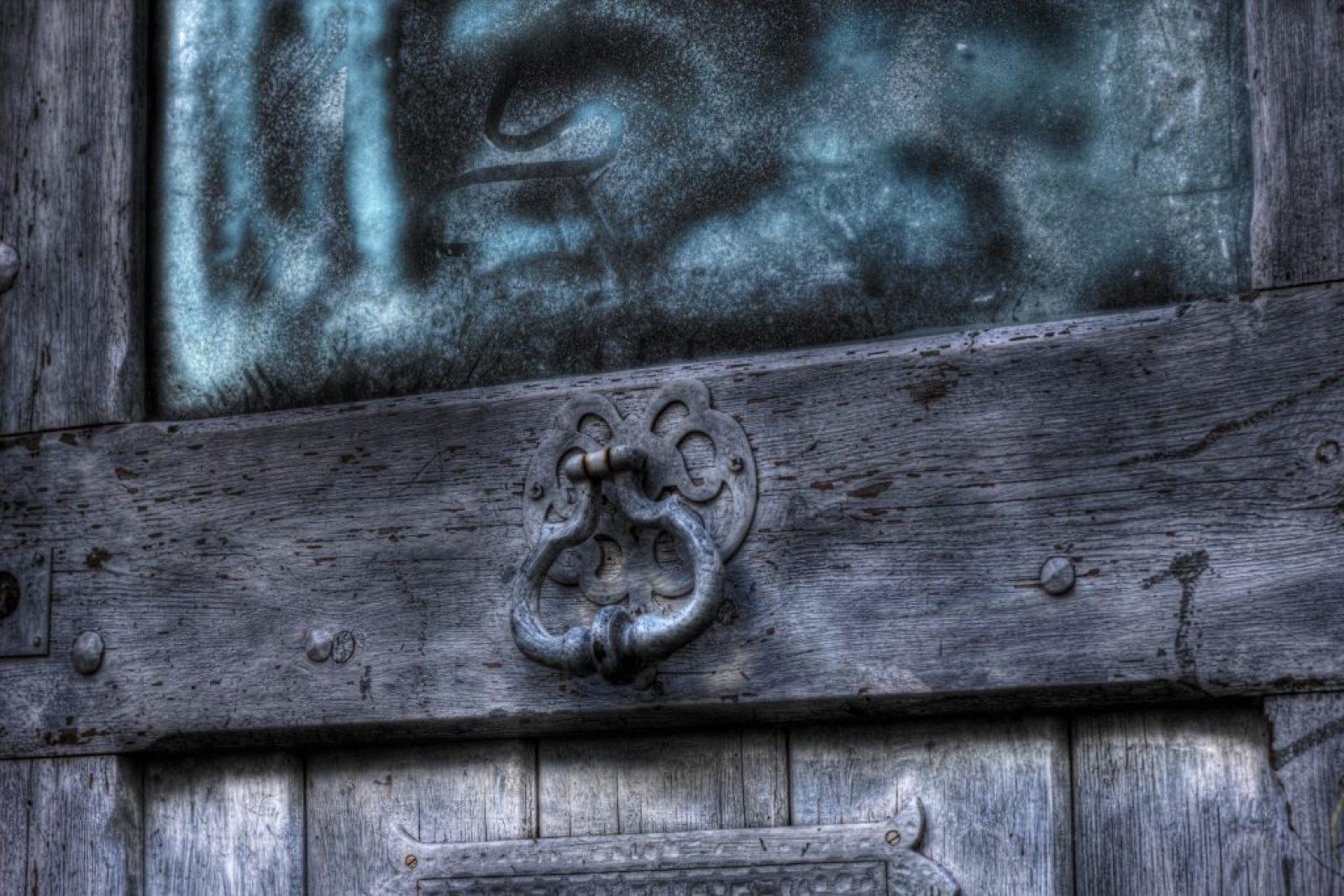 poignee porte ancienne bracketé